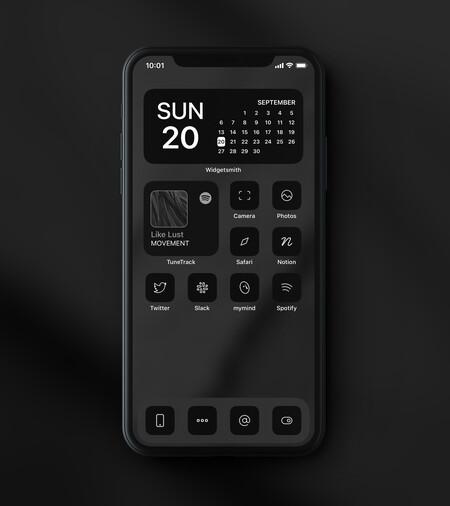 IPhone personnalisé avec des icônes noires et des silhouettes blanches.