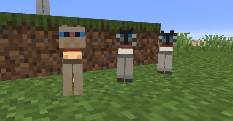Trois chats apprivoisés assis avec des colliers dans Minecraft