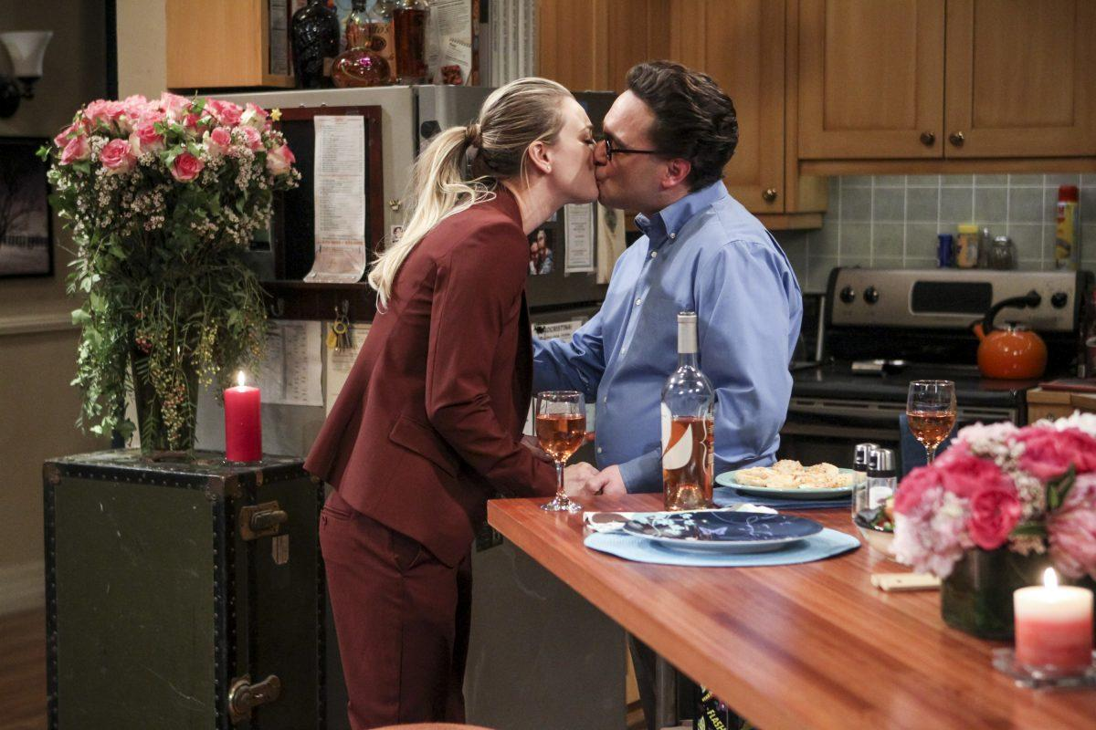 Penny and Leonard Hofstadter kiss in the kitchen on