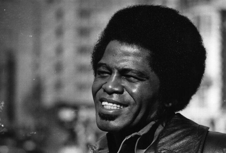 James Brown smiling in a black and white photo