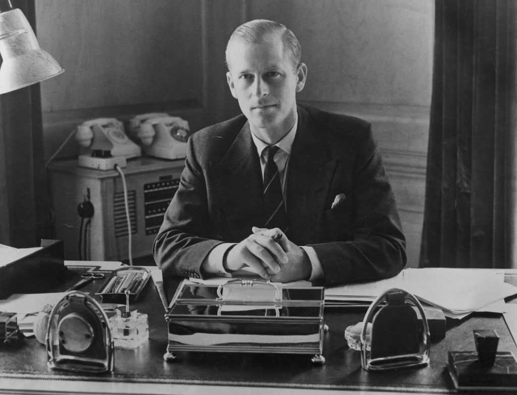 Prince Philip, the Duke of Edinburgh, sitting at his desk at Clarence House in 1951