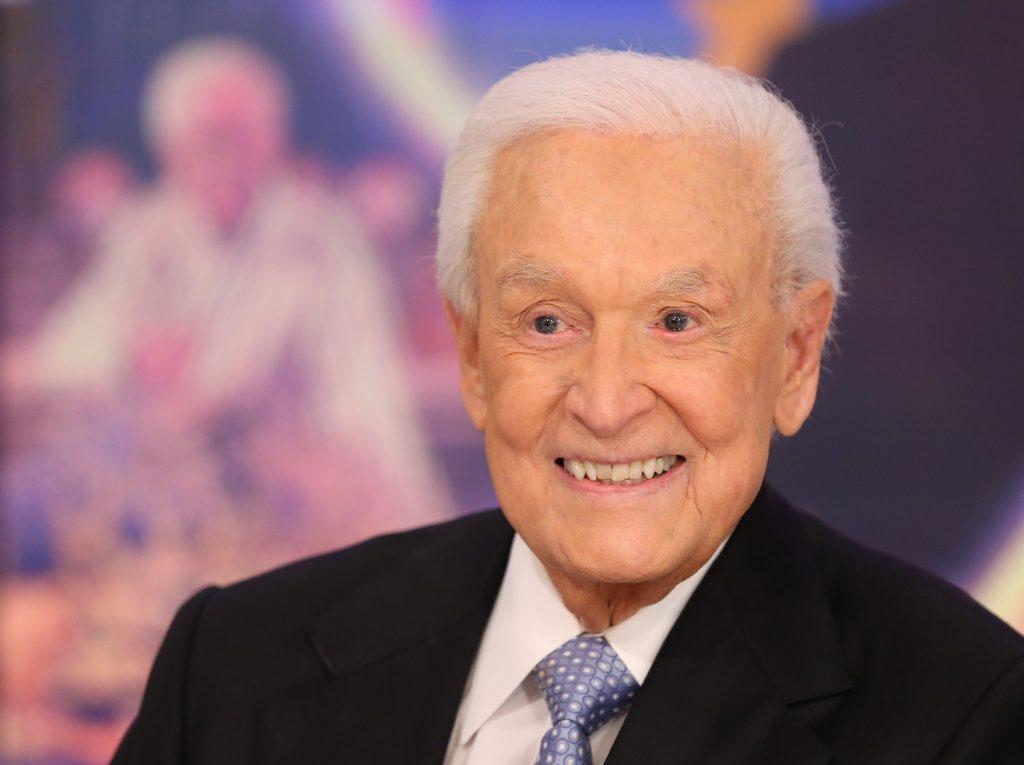 Bob Barker smiling in front of a blurred background