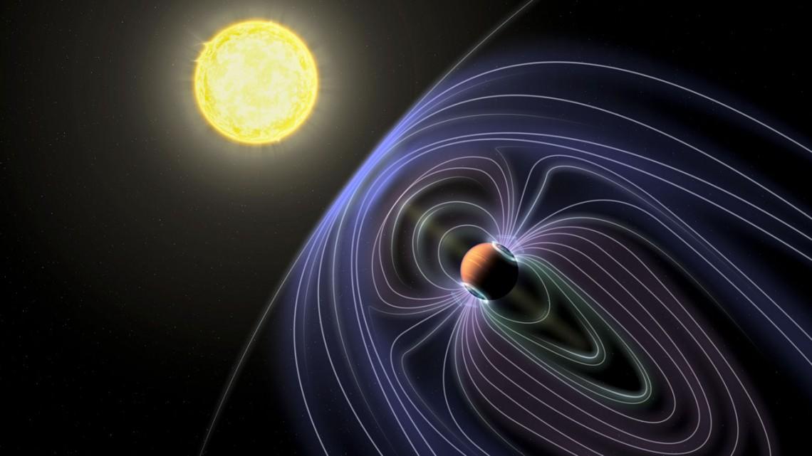 La représentation par un artiste de l'exoplanète Tau Boötes b montre un champ magnétique, qui peut provoquer les émissions radio que les scientifiques pensent avoir détectées.