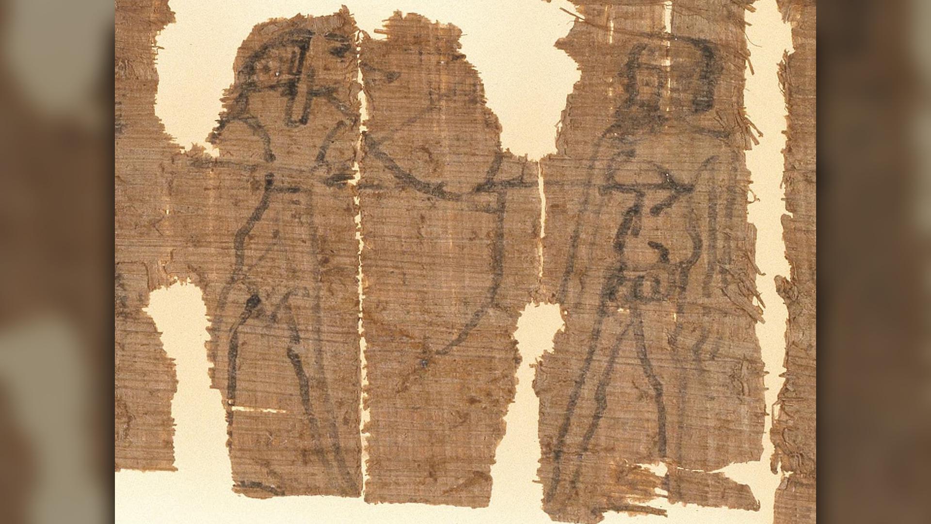 Un gros plan du papyrus montrant le dieu à tête de chacal égyptien Anubis tirant Kephalas avec une flèche.  Kephalas est représenté nu avec un pénis et un scrotum agrandis.  La flèche tirée par Anubis est censée rendre Kephalas lubrique pour une femme nommée Taromeway.