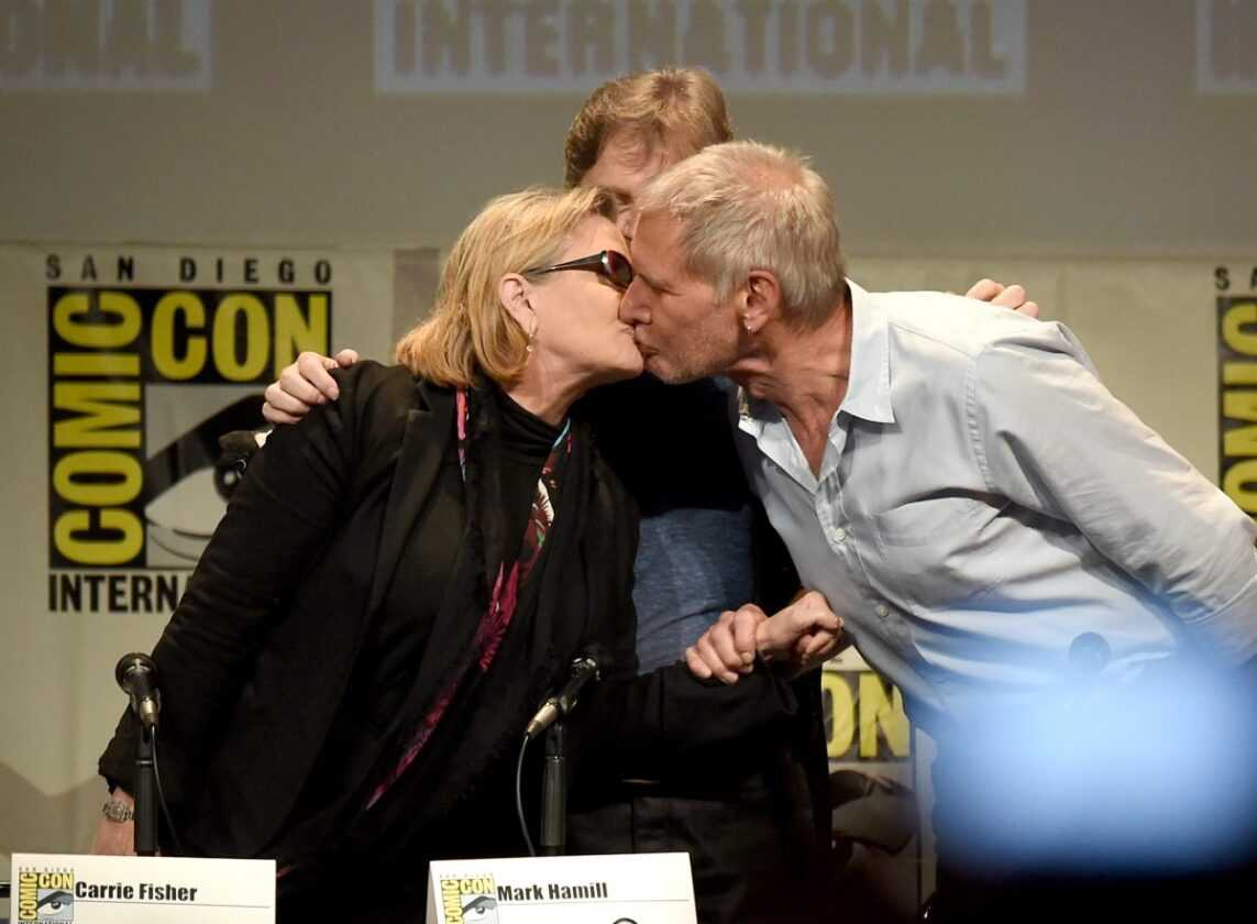 Actors Carrie Fisher, Mark Hamill and Harrison Ford pose onstage at the Lucasfilm panel during Comic-Con International 2015 at the San Diego Convention Center on July 10, 2015 in San Diego, California.