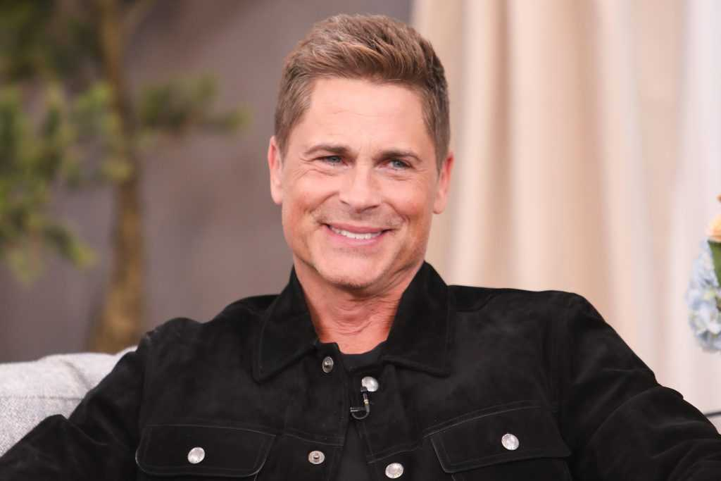 Rob Lowe smiling, turned to the side
