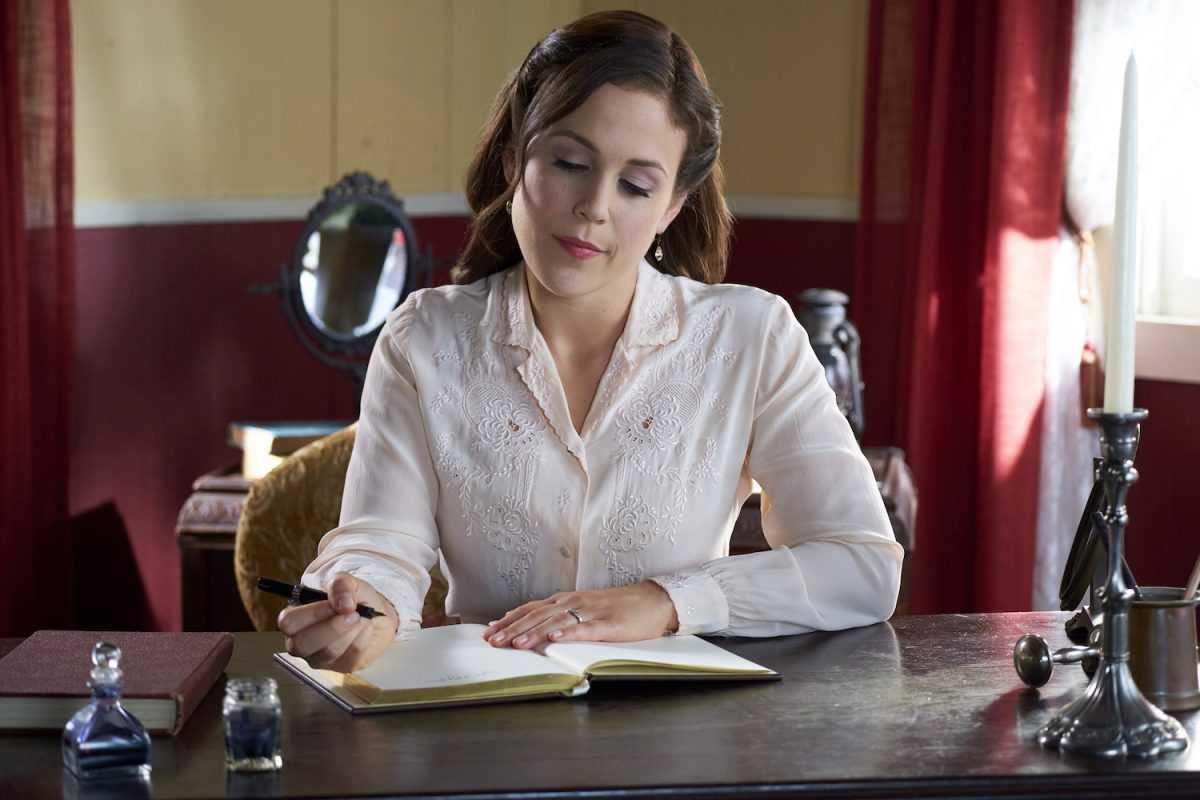 Elizabeth writing in a notebook
