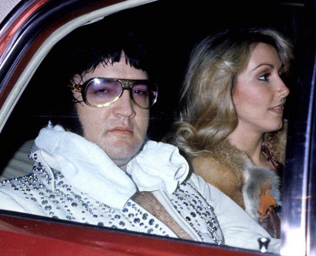 Elvis Presley with girlfriend Linda Thompson arriving at the Hilton Hotel