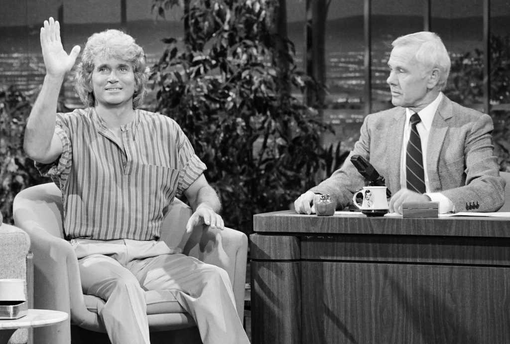Michael Landon, left, with Johnny Carson in 1983