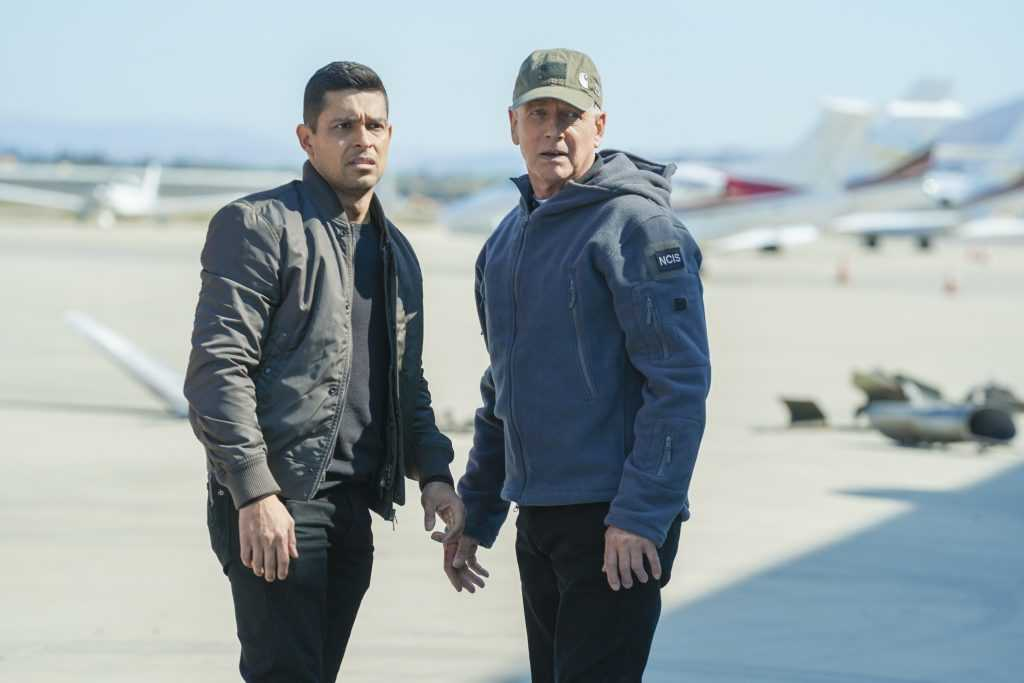 Wilmer Valderrama and Mark Harmon on the set of