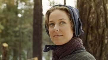 Karen Grassle as Caroline Quiner Holbrook Ingalls smiling in front of a tree