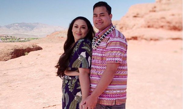 Kalani Faagata and Asuelu Pulaa smiling together in a desert