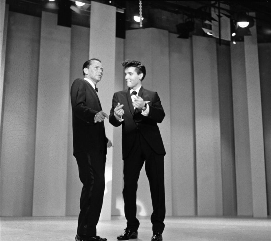 Frank Sinatra and Elvis Presley perform together on stage