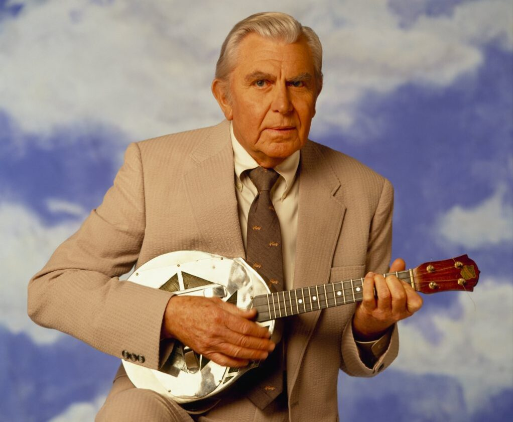 Andy Griffith poses for a photo with a banjo