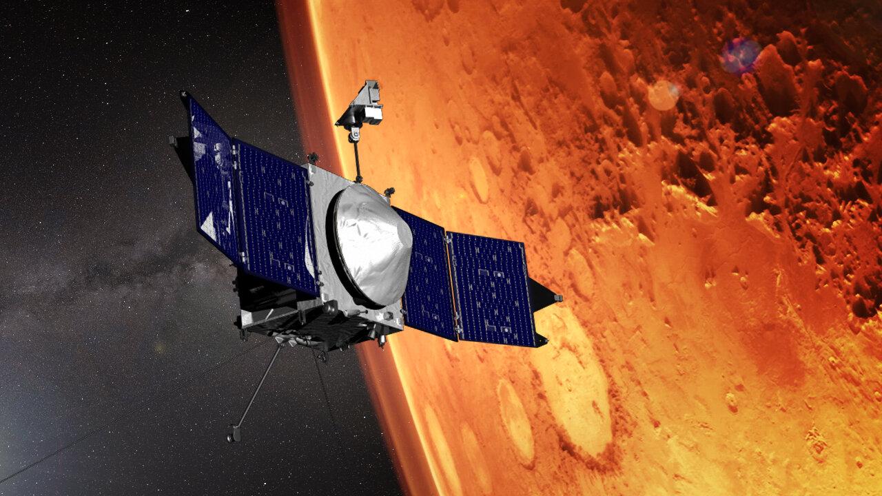 Représentation d'artiste du vaisseau spatial MAVEN de la NASA en orbite autour de Mars.
