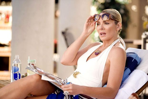 "Kim Cattrall comme Samantha Jones dans le premier film ""Sex and the City"" (Photo: New Line Cinema)"