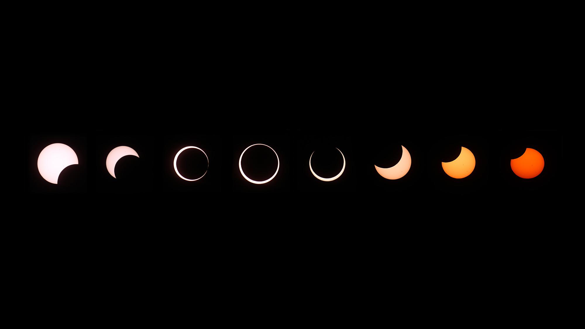 Un composite d'images d'une éclipse solaire annulaire montre plusieurs étapes, de gauche à droite, lorsque la lune passe devant le soleil.