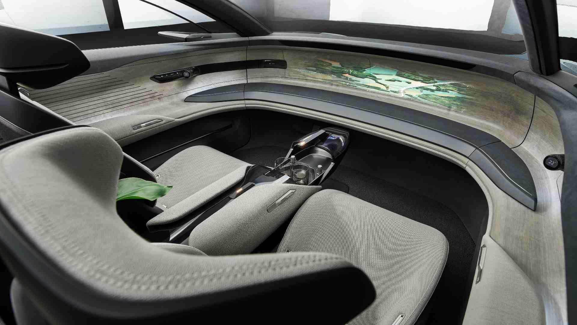 Les commandes de conduite dans la grande sphère se rangent lorsqu'elles ne sont pas nécessaires pour créer une ambiance «salon».  Image : Audi
