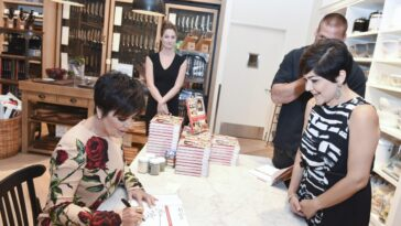 Kris Jenner signing her cookbook at an event in 2014.