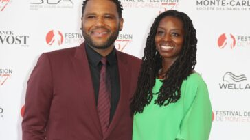 Anthony Anderson and wife Alvina Stewart smiling at the camera on the red carpet.